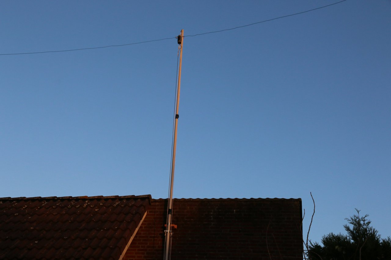 Fibreglass mast with antenna